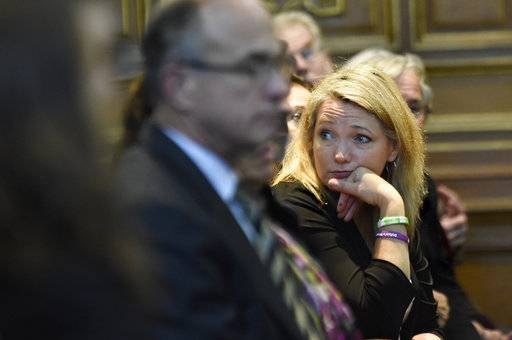Nicole Hockley, who lost her son, Dylan in the 2012 Sandy Hook School shooting, waits in the gallery at the state Supreme Court to hear arguments in a lawsuit filed against Remington Arms, in Hartford, Conn., Tuesday, Nov. 14, 2017.   A survivor and relatives of nine people killed in the shooting are trying to sue the North Carolina company that made the AR-15-style rifle used to kill 20 first-graders and six educators at Sandy Hook Elementary School. A lower court dismissed the lawsuit.  (Cloe Poisson/The Courant via AP, Pool)