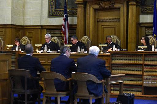 The state Supreme Court prepares to hear arguments in a lawsuit filed by nine of the Sandy Hook families against the manufacturer of the gun used in the 2012 Sandy Hook school shooting in Hartford, Conn., Tuesday, Nov. 14, 2017.   A survivor and relatives of nine people killed in the 2012 Newtown school massacre are trying to sue the North Carolina company that made the AR-15-style rifle used to kill 20 first-graders and six educators at Sandy Hook Elementary School. A lower court dismissed the lawsuit.  (Cloe Poisson/The Courant via AP, Pool)