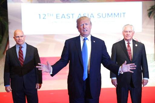 Flanked by U.S. National Security Advisor H.R. McMaster, left, and U.S. Secretary of State Rex Tillerson, right, U.S. President Donald Trump offers a departing statement after participating in an East Asia Summit, Tuesday, Nov. 14, 2017, in Manila, Philippines. Trump is on a five country trip through Asia traveling to Japan, South Korea, China, Vietnam and the Philippines.