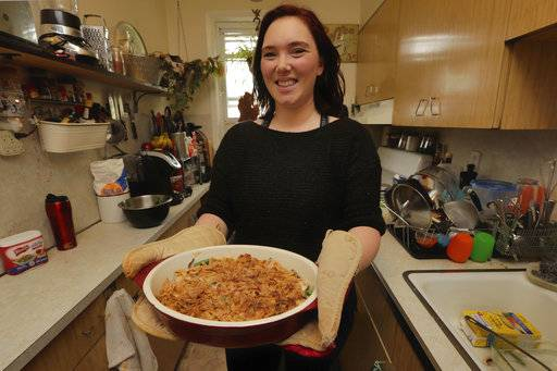 Ruthy Kirwan, of Percolate Kitchen, shows off the her version of the classic Thanksgiving favorite Green Been Casserole, in her apartment kitchen in the Queens borough of New York, Wednesday, Nov. 8, 2017. Before actors perform a play for an audience, they run a dress rehearsal to look for kinks that need fixing before the show opens. Traditional Thanksgiving dinner is a big production that can benefit from rehearsal, too, say some veteran hosts.