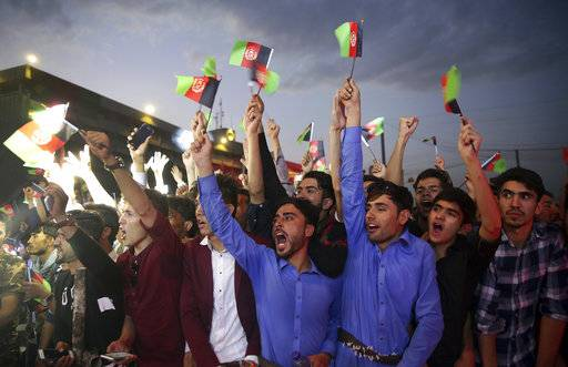 "FILE - In this Aug. 19, 2017 file photo, fans of singer Aryana Saeed cheer, during a concert to commemorate Afghanistan's Independence Day in Kabul, Afghanistan. The annual survey by the San Francisco-based Asia Foundation. released Tuesday, Nov. 14, 2017, has found that Afghans are slightly more optimistic about the future than they were last year, despite a stagnant economy and near-constant attacks by a revitalized Taliban. The foundation acknowledged that the slight increase in optimism is ""difficult to explain.�"