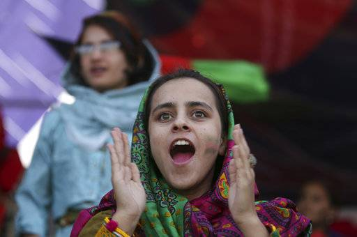 "FILE - In this Sept. 22, 2017 file photo, cricket fans celebrate during the Shpageeza Cricket League (SCL) final match in Kabul, Afghanistan. The annual survey by the San Francisco-based Asia Foundation, released Tuesday, Nov. 14, 2017, has found that Afghans are slightly more optimistic about the future than they were last year, despite a stagnant economy and near-constant attacks by a revitalized Taliban. The foundation acknowledged that the slight increase in optimism is ""difficult to explain.�"