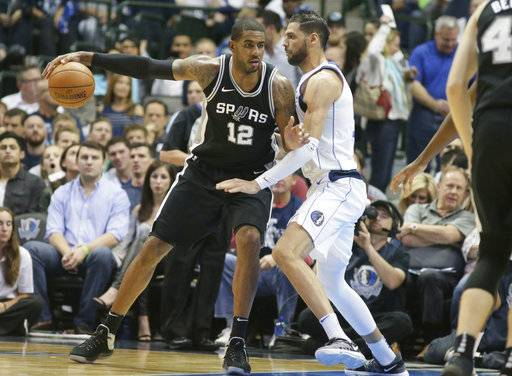 San Antonio Spurs forward LaMarcus Aldridge (12) is defended by Dallas Mavericks center Salah Mejri (50) during the first half of an NBA basketball game in Dallas, Tuesday, Nov. 14, 2017.