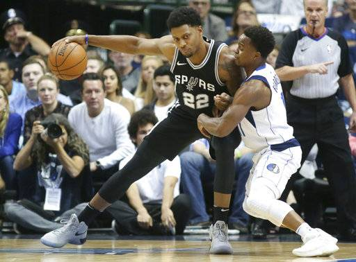 San Antonio Spurs forward Rudy Gay (22) dribbles against Dallas Mavericks guard Yogi Ferrell (11) during the first half of an NBA basketball game in Dallas, Tuesday, Nov. 14, 2017.