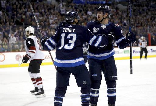 Winnipeg Jets' Brandon Tanev (13) and Andrew Copp (9) celebrate after Copp scored against the Arizona Coyotes during first period NHL hockey action in Winnipeg, Manitoba, Tuesday, Nov. 14, 2017. (Trevor Hagan/The Canadian Press via AP)