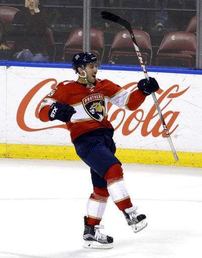 Florida Panthers' Vincent Trocheck celebrates after scoring during the shootout in an NHL hockey game against the Dallas Stars, Tuesday, Nov. 14, 2017, in Sunrise, Fla. The Panthers won 4-3.
