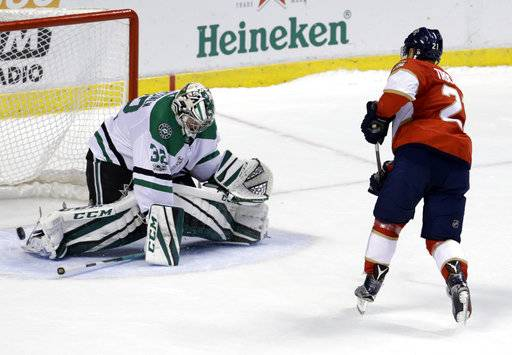 Florida Panthers' Vincent Trocheck, right, scores against Dallas Stars goalie Kari Lehtonen (32), of Finland, during the shootout in an NHL hockey game, Tuesday, Nov. 14, 2017, in Sunrise, Fla. The Panthers won 4-3.