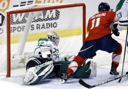 Florida Panthers' Jonathan Huberdeau (11) scores a goal against Dallas Stars goalie Kari Lehtonen (32), of Finland, during the first period of an NHL hockey game, Tuesday, Nov. 14, 2017, in Sunrise, Fla.