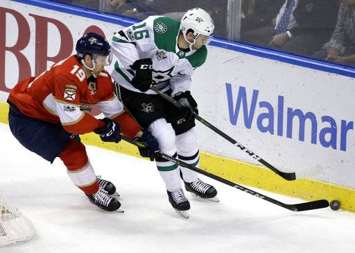 Florida Panthers' Mike Matheson (19) and Dallas Stars' Jason Dickinson (16) go for the puck during the first period of an NHL hockey game, Tuesday, Nov. 14, 2017, in Sunrise, Fla.