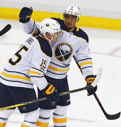 Buffalo Sabres' Evander Kane (9) celebrates his goal with Jack Eichel (15) in the first period of an NHL hockey game against the Pittsburgh Penguins in Pittsburgh, Tuesday, Nov. 14, 2017.