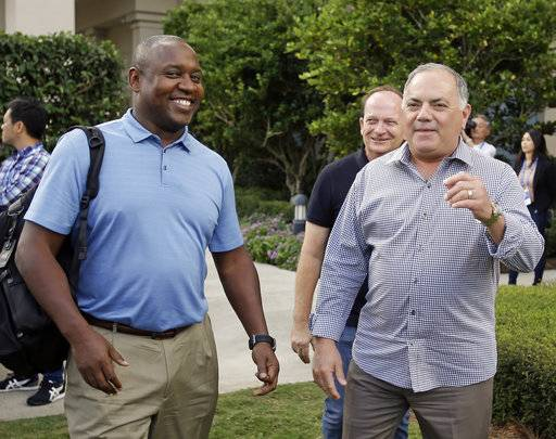 Michael Hill, left, president of baseball operations for the Miami Marlins and Al Avila, right, executive vice president of baseball operations and general manager of the Detroit Tigers greet members of the media at the annual MLB baseball general managers' meetings, Tuesday, Nov. 14, 2017, in Orlando, Fla.