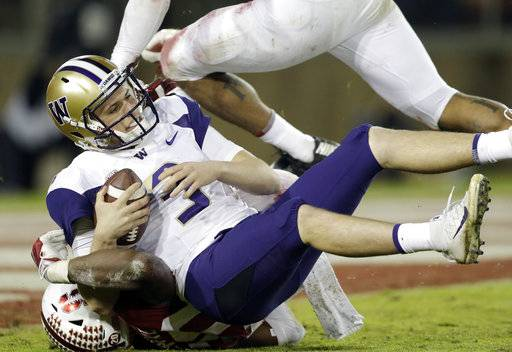 Washington quarterback Jake Browning is sacked by Stanford linebacker Bobby Okereke, bottom, during the second half of an NCAA college football game Friday, Nov. 10, 2017, in Stanford, Calif. Stanford won 30-22.