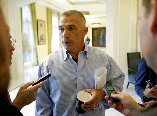Former New York Yankees manager Joe Girardi talks with reporters at the annual MLB  general managers' meetings, Tuesday, Nov. 14, 2017, in Orlando, Fla.
