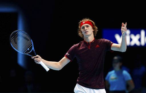 Alexander Zverev gestures during his match against Roger Federer on day three of the ATP Finals at the O2 Arena in London,  Tuesday Nov. 14, 2017. Federer guaranteed his place in Saturday's semifinals by defeating Alexander Zverev 7-6, 5-7, 6-1. (John Walton/PA via AP)