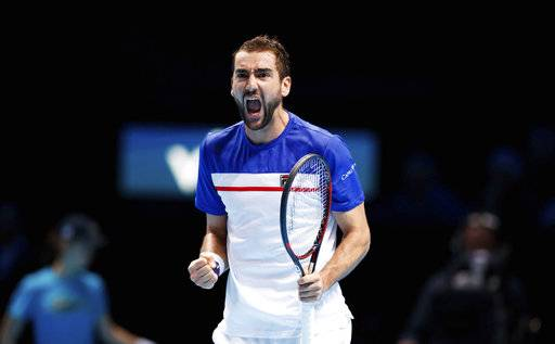 Croatian Marin Cilic celebrates taking the opening set against American player Jack Sock, during day three of the ATP World Tour Finals being played at the O2 Arena in London, Tuesday Nov. 14, 2017. ( John Walton/PA via AP)