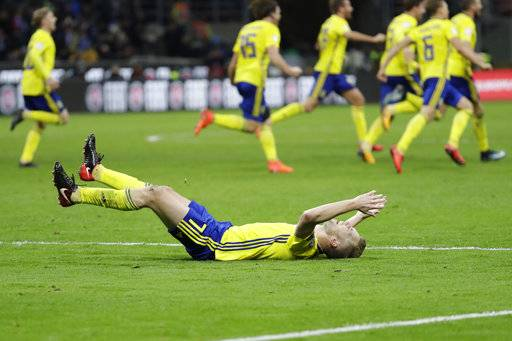Swedish players react to their qualification at the end of the World Cup qualifying play-off second leg soccer match between Italy and Sweden, at the Milan San Siro stadium, Italy, Monday, Nov. 13, 2017.