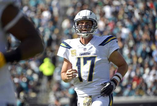FILE - In this Sunday, Nov. 12, 2017, file photo, Los Angeles Chargers quarterback Philip Rivers shouts to teammates during the first half of an NFL football game against the Jacksonville Jaguars in Jacksonville, Fla. Rivers is in the NFL's concussion protocol after experiencing possible symptoms of a head injury, endangering his streak of 194 consecutive starts since 2006. Rivers told the Chargers about his symptoms Monday after they returned from a 20-17 overtime loss in Jacksonville, coach Anthony Lynn said.