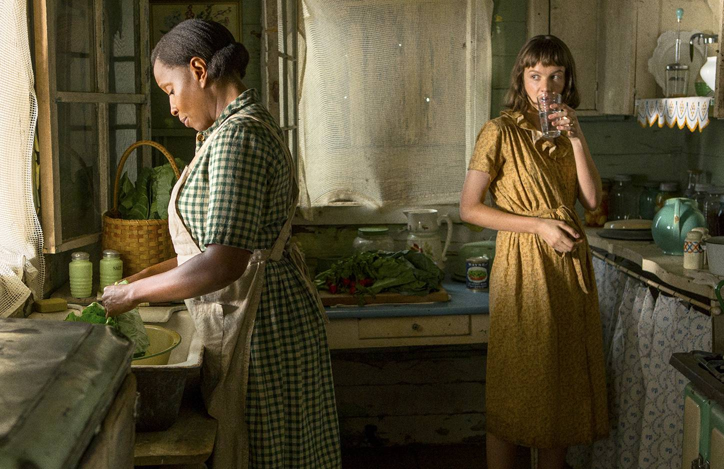 "Florence (Mary J. Blige), left, and Laura (Carey Mulligan) both struggle as their families work the same patch of land in the Mississippi Delta in ""Mudbound."""