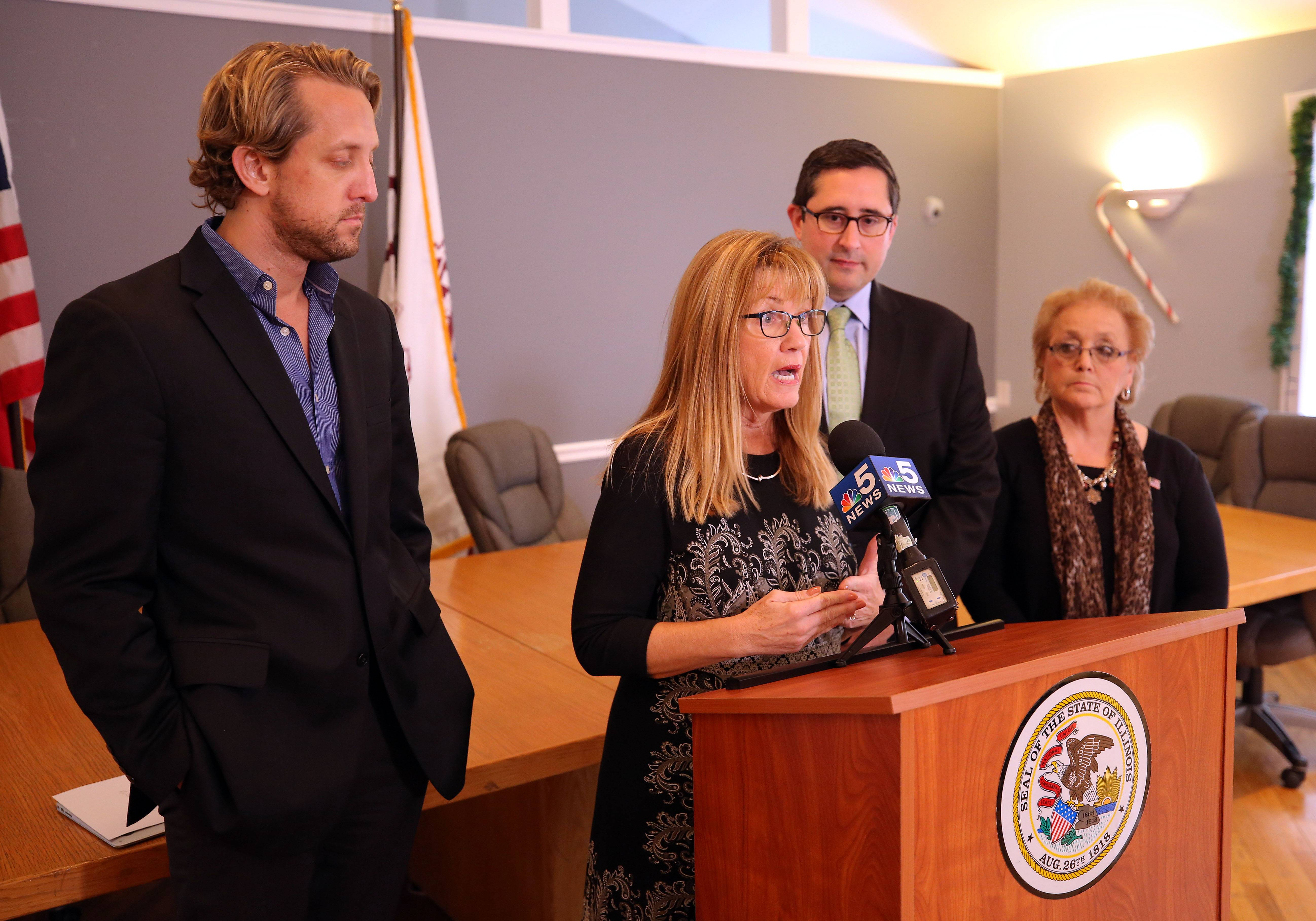 From left, Lake County Board Chairman Aaron Lawlor, state Sen. Melinda Bush, state Rep. Sam Yingling and Round Lake Park Mayor Linda Lucassen at a news conference Thursday to discuss the new law which provides tax relief to local flood victims.