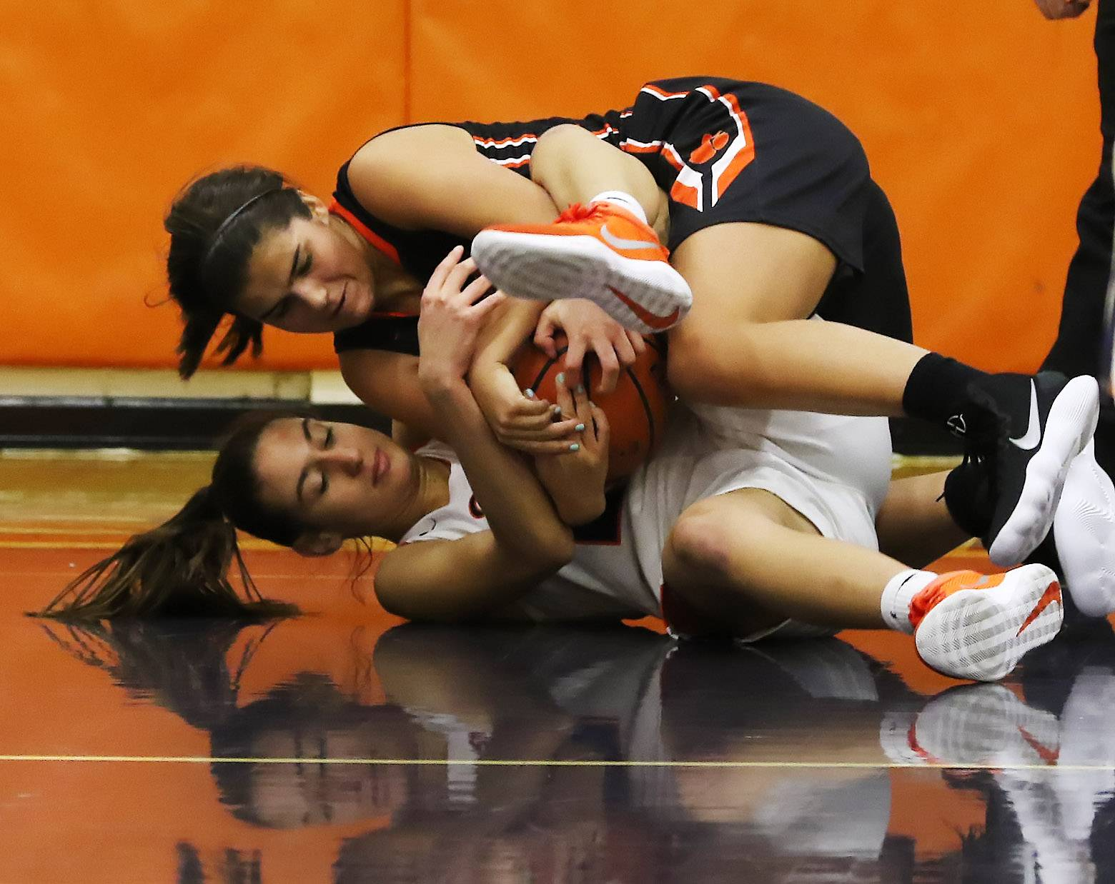 Libertyville guard Emma Manolovic, top, battles Buffalo Grove guard Zori Angelova for the ball on Thursday at Buffalo Grove.