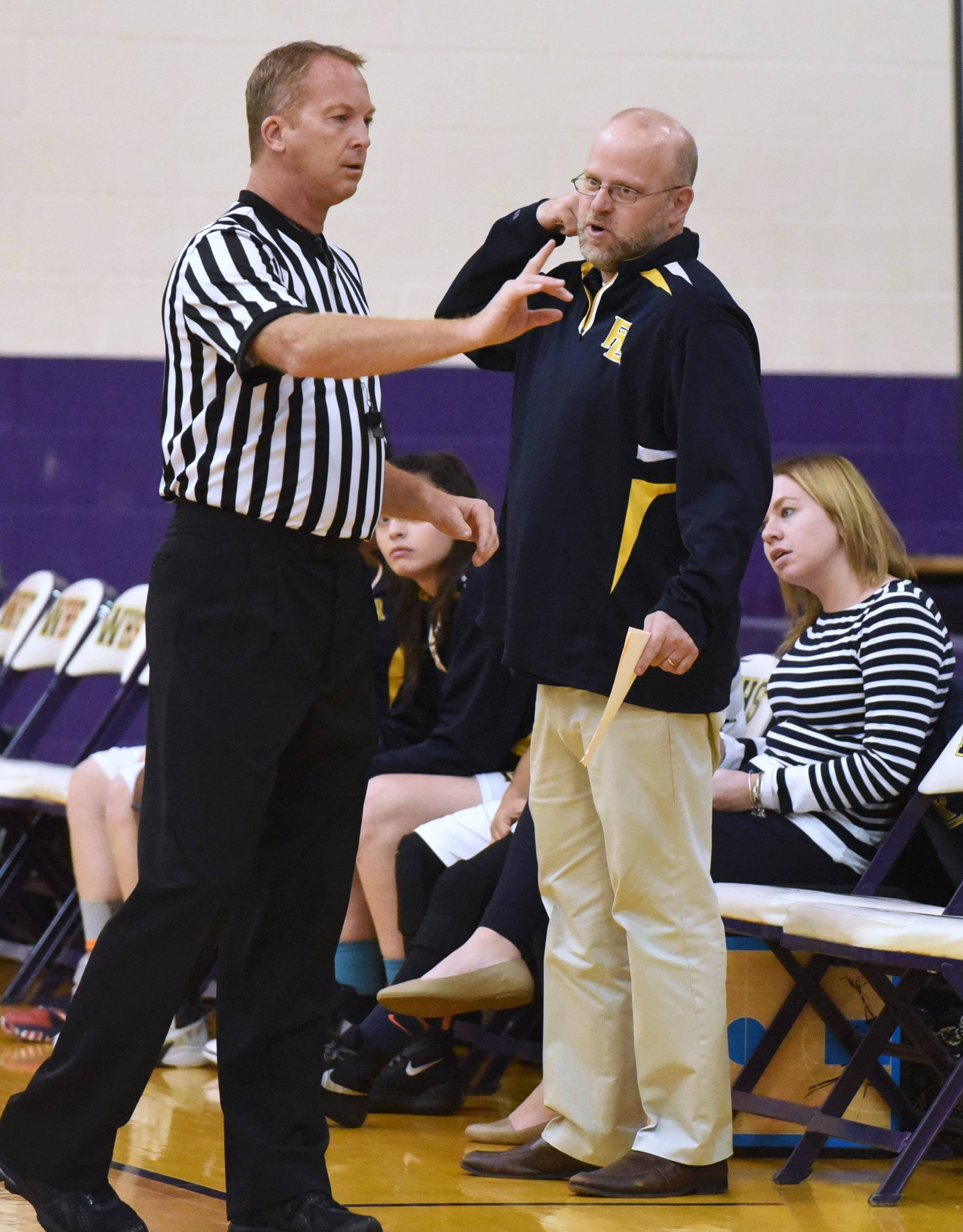 Girls basketball coach Doug Barnshaw, here having a word with a referee last season at Wauconda, is carrying on Howard Conkling's proud legacy with this year's players at Round Lake.