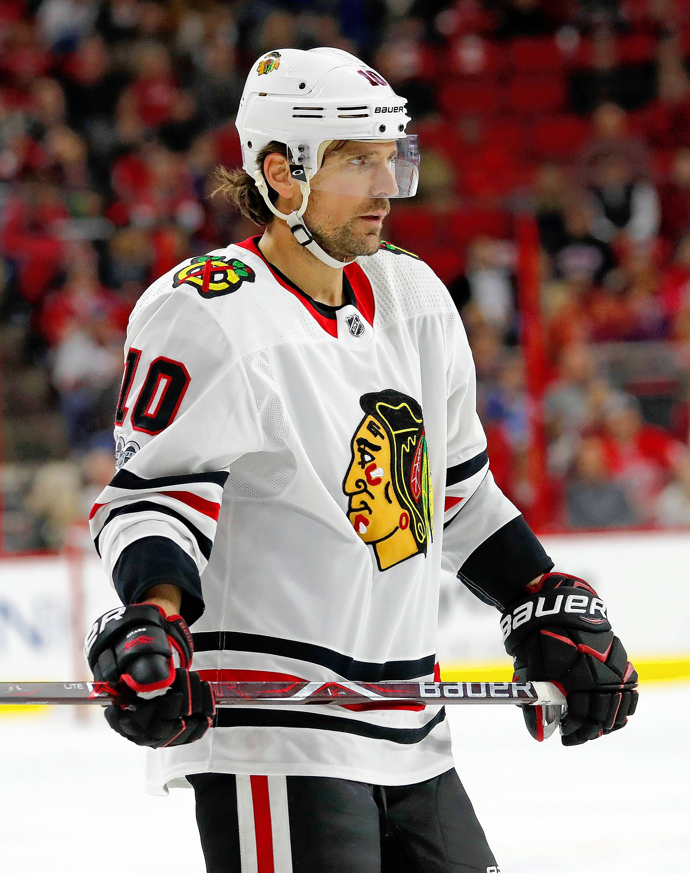 Chicago Blackhawks' Patrick Sharp (10) waits for the face off during the first period of an NHL hockey game against the Carolina Hurricanes, Saturday, Nov. 11, 2017, in Raleigh, N.C. (AP Photo/Karl B DeBlaker)