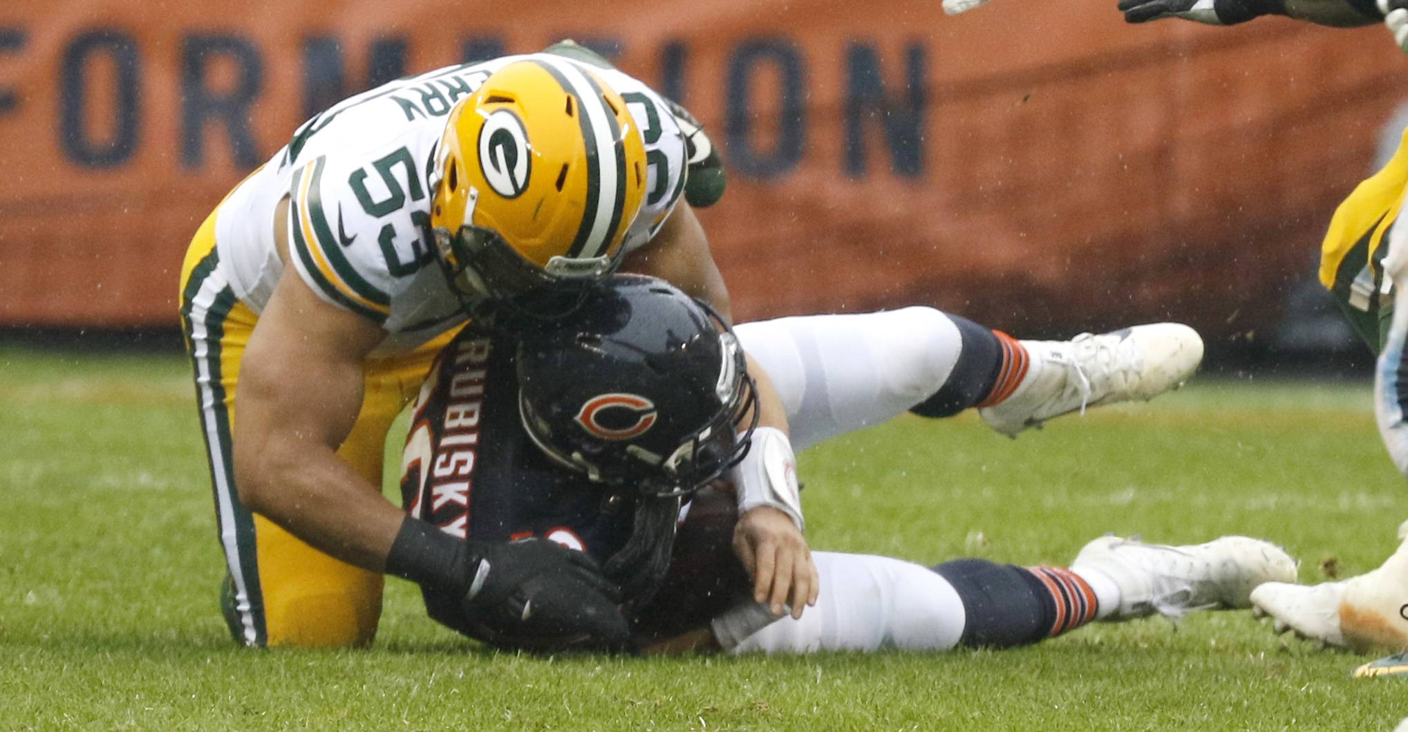 "Bears quarterback Mitchell Trubisky is sacked by Green Bay Packers Nick Perry in the first half. ""We're still taking too many sacks,"" offensive coordinator Dowell Loggains said on Thursday after Trubisky was dropped five times by the Packers Sunday. ""That's a combination of all 11 guys out there, and Mitchell is part of that process."""