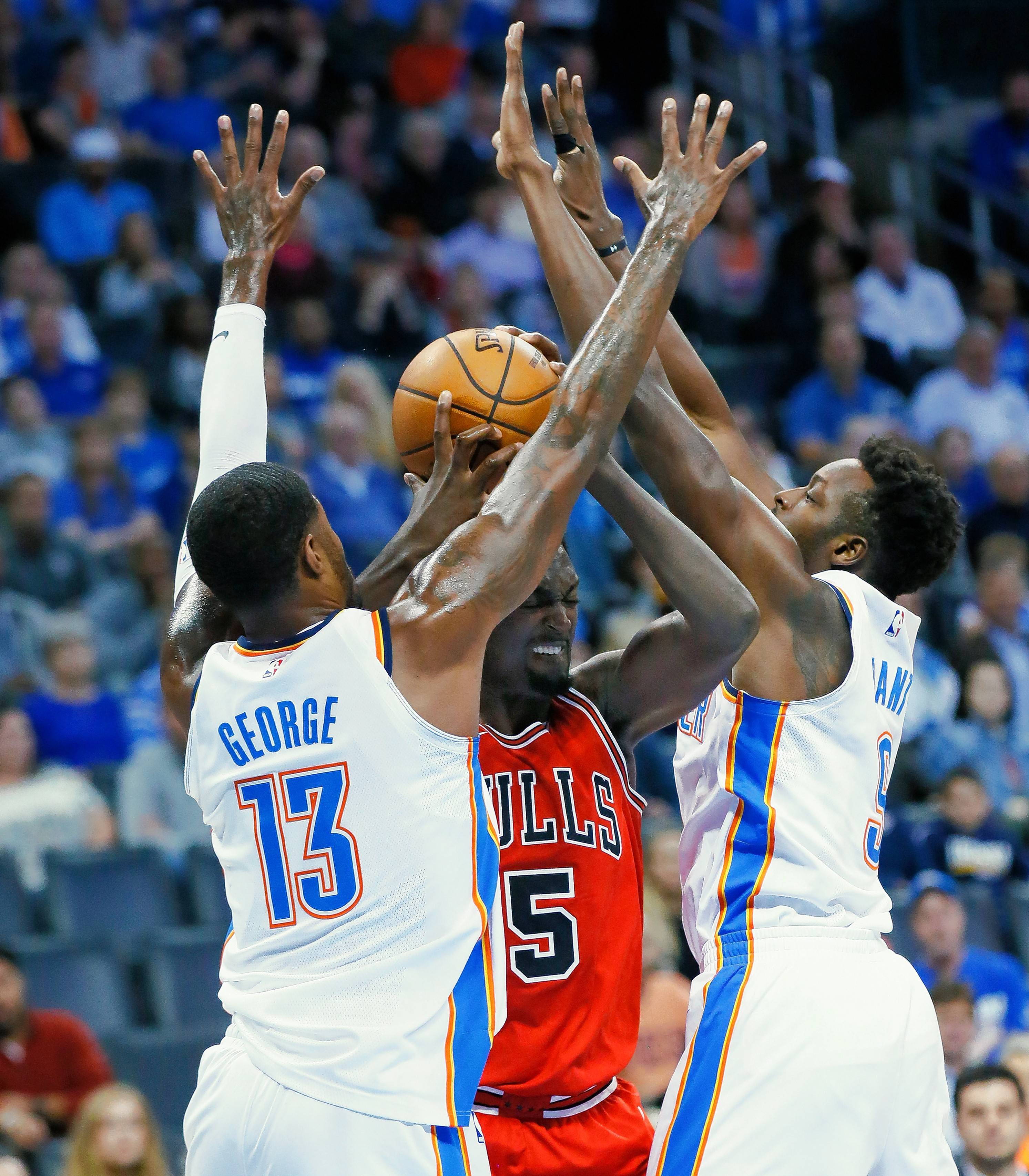 Oklahoma City was in control as the Chicago Bulls offense struggled to score in the first quarter of Wednesday's game. Here forward Bobby Portis runs into a double team by the Thunder's Paul George, left, and forward Jerami Grant.