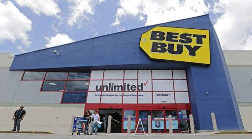 In this Monday, May 22, 2017, photo, people walk out of a Best Buy store after purchasing an LED TV, in Hialeah, Fla. Best Buy Co. Inc. reports earnings Thursday, Nov. 16, 2017. (AP Photo/Alan Diaz)