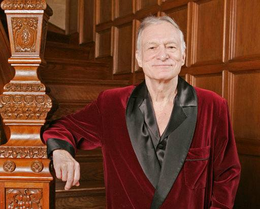 "FILE - In this April 7, 2006 file photo, Playboy founder Hugh Hefner poses at the Playboy Mansion in the Holmby Hills area of Los Angeles. Norman Lear, Cindy Crawford, Berry Gordy, Kim Basinger, Bill Maher and the Rev. Jesse Jackson are among the stars offering tributes to Hefner in a special edition of Playboy hitting newsstands this week. ""Celebrating Hef"" chronicles the Playboy magazine founder's life in words and photos, with the celebrity essays highlighting Hefner's support for civil rights and first-amendment freedoms. (AP Photo/Kevork Djansezian, File)"