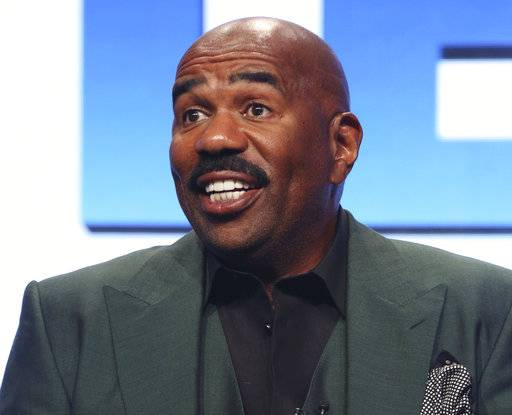 "FILE - In this Aug. 3, 2017 file photo, host/executive producer Steve Harvey participates in the ""Steve"" panel during the NBC Television Critics Association Summer Press Tour in Beverly Hills, Calif. Harvey will be stationed in Times Square for ""Fox's New Year's Eve with Steve Harvey."" It will air Sunday, Dec. 31, from 8 to 10 p.m. and from 11 p.m. to 12:30 a.m. (Photo by Willy Sanjuan/Invision/AP, File)"