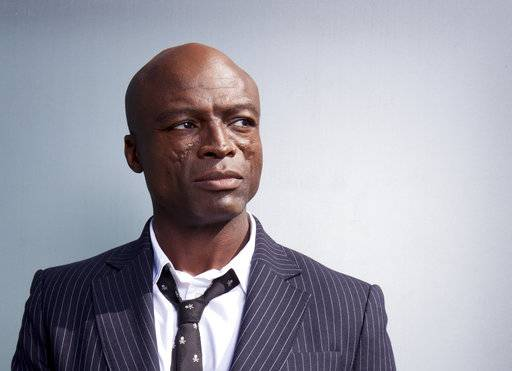 "In this Oct 18, 2017 photo, Grammy Award-winning singer Seal poses for a portrait to promote his new album ""Standards"" at the London Hotel in West Hollywood, Calif. His tenth studio album was recorded with a band that included musicians who performed alongside Frank Sinatra and Ella Fitzgerald. (Photo by Rebecca Cabage/Invision/AP)"