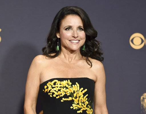"FILE - In this Sept. 17, 2017 file photo, Julia Louis-Dreyfus arrives at the 69th Primetime Emmy Awards in Los Angeles. A producer of ""Veep� says filming of the HBO comedy has been postponed as its star, Julia Louis-Dreyfus, undergoes treatment for breast cancer. During an interview on SiriusXM Wednesday, Nov. 15, Frank Rich said production of the new season was awaiting her recovery. (Photo by Richard Shotwell/Invision/AP, File)"