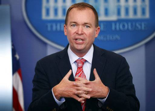 FILE - In this Thursday, July 20, 2017, file photo, Budget Director Mick Mulvaney gestures as he speaks during the daily press briefing at the White House in Washington. Mulvaney is expected to take on a second role in the Trump administration as acting director of a consumer financial agency created by the Obama administration. Mulvaney is expected to be named to lead the Consumer Financial Protection Bureau on an acting basis in addition to his duties as director of the Office of Management and Budget. (AP Photo/Pablo Martinez Monsivais, File)