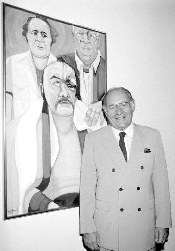 "In this May 10, 1984, file photo, Ferdie Pacheco stands in front of his painting of boxer Chuck Wepner at Manhattan's Spectrum Fine Art Gallery in New York. Fernando ""Ferdie� Pacheco, ""The Fight Doctor� who served as Muhammad Ali's ringside physician, died Thursday morning, Nov. 16, 2017, at his Miami home after prolonged illness, his daughter, Tina Louise Pacheco, said. He was 89. (AP Photo/Lance Jeffrey)"