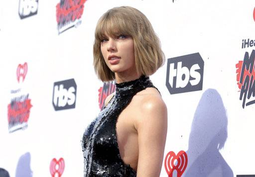 "FILE - In this April 3, 2016 file photo, Taylor Swift arrives at the iHeartRadio Music Awards in Inglewood, Calif. In just four days, Swift's new album has sold more traditional albums than any other release this year. Billboard reports that ""reputation� has sold 1.05 million copies in the first four days of its release. The album came out on Nov. 10. (Photo by Richard Shotwell/Invision/AP, File)"