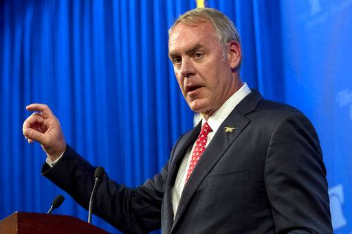 "FILE - In this Sept. 29, 2017, file photo, Interior Secretary Ryan Zinke speaks at the Heritage Foundation in Washington. Zinke is complaining that Senate Democrats are holding the department's nominees ""hostage"" to a political agenda that includes opposition to Zinke's review of presidentially designated monuments. (AP Photo/Andrew Harnik, File)"