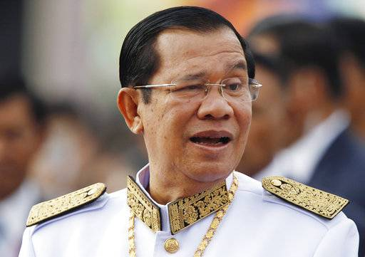 FILE - In this Nov. 9, 2017, file photo, Cambodia's Prime Minister Hun Sen waits to attend the Independence Day celebrations in Phnom Penh, Cambodia. The government accuses the opposition Cambodia National Rescue Party of involvement in a plot to topple the government and has asked the judiciary to dissolve it. CNRP officials have denied the charges, saying they are politically motivated. (AP Photo/Heng Sinith, File)