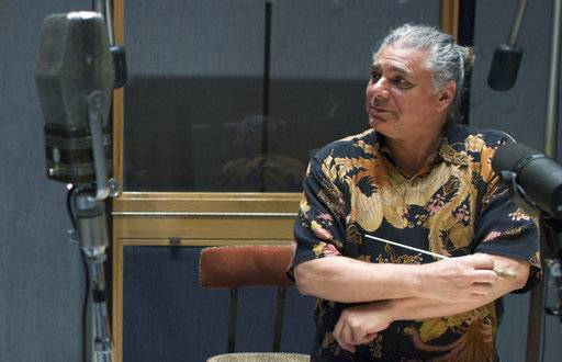 "FILE - In this June 24, 2008 file photo, composer Paul Buckmaster looks on before recording a session of British pop musician Jamie Cullum's ""I Think, I Love"" at Capitol Studios in Los Angeles. Buckmaster, who arranged and orchestrated some of the best-known songs of David Bowie, the Rolling Stones and Elton John among others in a career that spanned a half-century, has died. His assistant, Diana Post, said Buckmaster died on Nov. 7, 2017, in Los Angeles. He was 71. (AP Photo/Damian Dovarganes, File)"