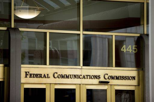 FILE - This June 19, 2015, file photo, shows the Federal Communications Commission building in Washington. On Thursday, Nov. 16, 2017, the FCC voted to loosen rules meant to support independent local media. The newspaper and broadcasting industries say they need the changes to deal with growing competition from the web and cable companies. Critics say dumping these rules, by encouraging consolidation, hurts media diversity. (AP Photo/Andrew Harnik, File)