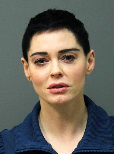 This image released Tuesday, Nov. 14, 2017 by the Loudoun County Sheriff's Office shows the booking photo for actress Rose McGowan who surrendered to Airports Authority Police on charges of possession of a controlled substance. The felony charge stems from a police investigation of personal belongings left behind on a Jan. 20 flight that arrived at Washington Dulles International Airport in Virginia. Police say the items tested positive for narcotics. (Loudoun County Sheriff's Office via AP)