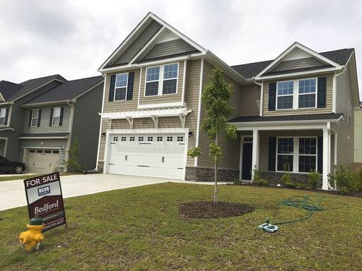 This Wednesday, Sept. 6, 2017, photo shows a new home for sale in a housing development in Raeford, N.C. On Thursday, Nov. 16, 2017, Freddie Mac reports on the week's average U.S. mortgage rates. (AP Photo/Swayne B. Hall)