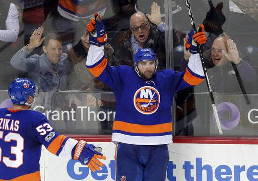 New York Islanders defenseman Johnny Boychuk (55) celebrates after scoring the go-ahead goal against the Carolina Hurricanes during the third period of an NHL hockey game, Thursday, Nov. 16, 2017, in New York. The Islanders won 6-4. (AP Photo/Julie Jacobson)
