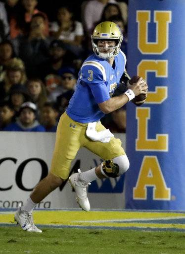 FILE - In this Nov. 11, 2017, file photo, UCLA quarterback Josh Rosen looks to pass against Arizona State during the first half of an NCAA college football game in Pasadena, Calif. Sam Darnold and Josh Rosen have become friends while growing into top NFL quarterback prospects with crosstown rivals Southern California and UCLA. They'll meet on the field for the first time Saturday - and it will probably be the last time until they get together again on Sundays.(AP Photo/Chris Carlson, File)