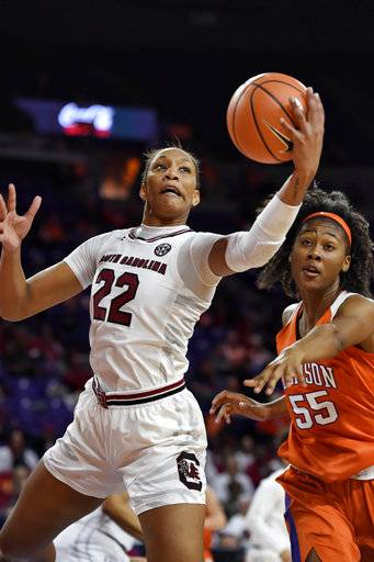 South Carolina's A'ja Wilson, left, grabs a rebound while defended by Clemson's Tylar Bennett, right, during the first half of an NCAA college basketball game Thursday, Nov. 16, 2017, in Clemson, S.C. (AP Photo/Richard Shiro)