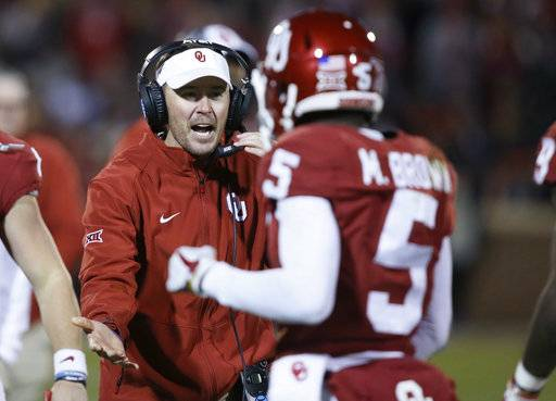 "FILE- In this Oct. 28, 2017, file photo, Oklahoma coach Lincoln Riley greets wide receiver Marquise Brown (5) as he comes back to the bench during the third quarter of an NCAA college football game against Texas Tech in Norman, Okla., Saturday, Oct. 28, 2017. The most straightforward championship game scenario for the Big 12 would be No. 3 Oklahoma and No. 11 TCU both winning their remaining two games and meeting again Dec. 2. Then again, nothing ever seems to come that easy for the Big 12. ""Look, there's never a perfect answer. We've always said that, and everybody knows that,� Riley said. ""The best thing being is you're going to have the best two teams in the league playing again there on the last week."" (AP Photo/Sue Ogrocki, File)"
