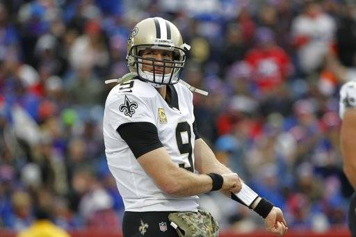 FILE - This Nov. 12, 2017 file photo shows New Orleans Saints quarterback Drew Brees (9) playing during the second half of an NFL football game against the Buffalo Bills in Orchard Park, N.Y. Brees is averaging fewer yards per game passing than at any point in his 11-plus seasons with New Orleans. Yet he has been pleased about the way he's connected with his receivers during New Orleans' seven-game winning streak. Overshadowed by dramatic improvements in the Saints' running game and defense is the fact that the 38-year-old Brees has been as efficient as ever. His completion percentage of 71.7 puts him on pace to set an NFL record. (AP Photo/Jeffrey T. Barnes, file)
