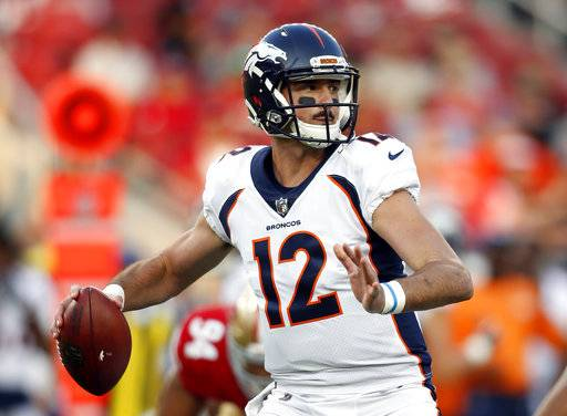 FILE - In this Aug. 19, 2017, file photo, Denver Broncos quarterback Paxton Lynch (12) throws during the first half of a preseason NFL football game against the San Francisco 49ers in Santa Clara, Calif. Unless the Broncos can steer their way out of a season that is skidding out of control, Lynch looks like he will get the starting quarterback gig he has never been able to earn on his own. (AP Photo/D. Ross Cameron, File)
