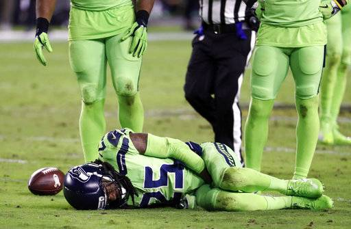 FILE - In this Thursday, Nov. 9, 2017, file photo, Seattle Seahawks cornerback Richard Sherman (25) lies injured on the turf he injured his Achilles tendon tackling Arizona Cardinals wide receiver John Brown during the second half of an NFL football game in Glendale, Ariz. The Seahawks return to practice Tuesday, Nov. 14, 2017, without Sherman and facing questions about how the team handled the concussion protocol with quarterback Russell Wilson. (AP Photo/Rick Scuteri, File)