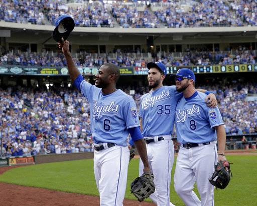 FILE- This Oct. 1, 2017, file photo shows Kansas City Royals players Lorenzo Cain (6), Eric Hosmer (35) and Mike Moustakas (8) acknowledging the crowd as they come out of the game during the fifth inning of a baseball game against the Arizona Diamondbacks in Kansas City, Mo. Hosmer, Moustakas and Cain were among nine free agents who turned down $17.4 million qualifying offers from their teams Thursday, Nov. 16, 2017. (AP Photo/Charlie Riedel, File)